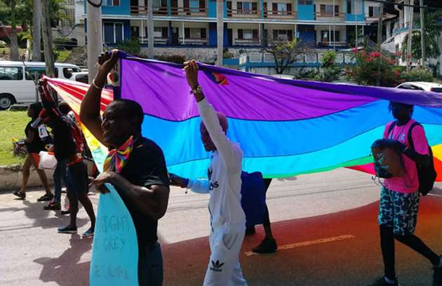Group marching at Montego Bay Pride in Jamaica.