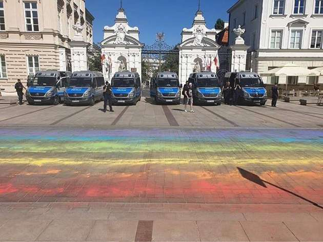 LGBT+ campaigners chalked the road with a rainbow flag before the protests started.