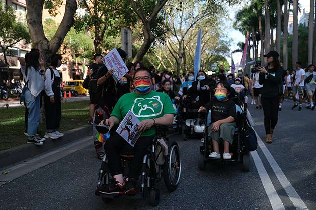 Pride-goers in wheelchairs.