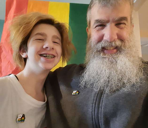 Dad and daughter pose for Pride.