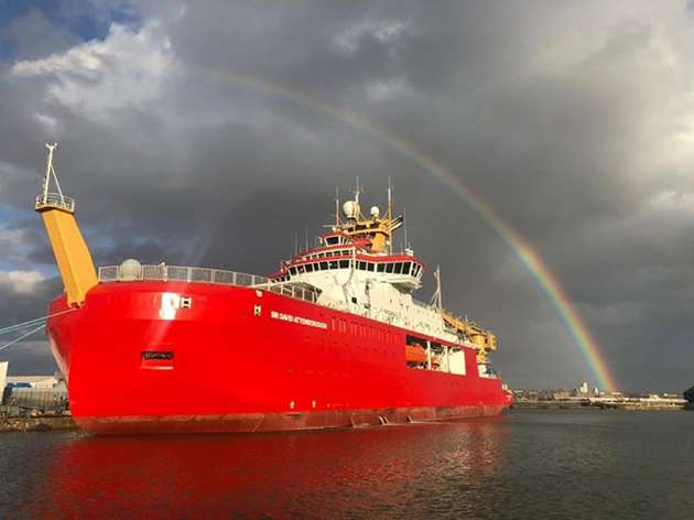 A rainbow crowns the research ship named after TV naturalist David Attenborough.