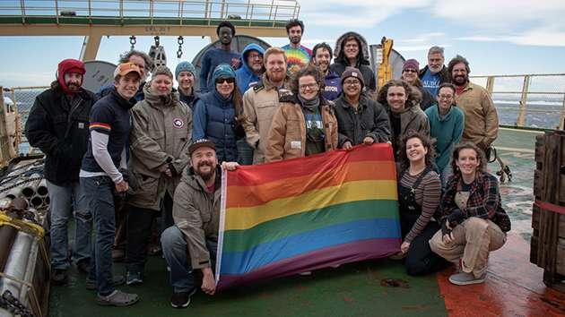 Crew celebrate Polar Pride on a research ship.